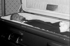 Malcolm X's body on display at his funeral. The publicizing of political figures' dead bodies was a clear way to make the black community understand that even the most militant leaders like Malcolm X were not immune to being killed.