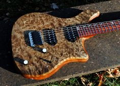 1-piece Burl Maple top on a 1-piece Quilted Sapele body featuring a Cocobolo neck and Fretboard with Schaller Hannes Bridge