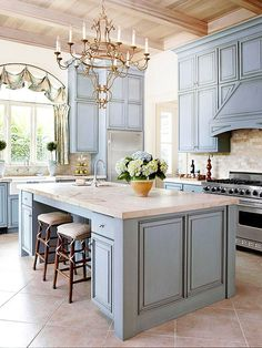 Cottage Kitchen with limestone tile floors, Complex granite counters, Laila 6 light chandelier in rustic antique bronze