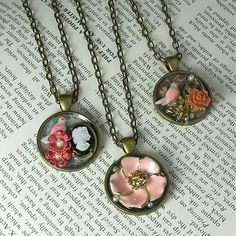 Collage pendants. I wonder if you could use the shrinky dink alternative to make some of the little flowers and such.