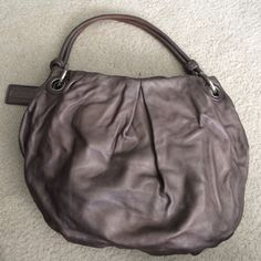 Coach hobo bag Used pewter colored hobo bag. Wear noted on underside of handles Coach Bags Hobos