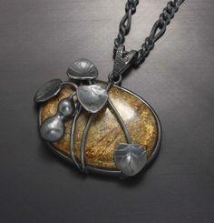 Gourd motif silver pendant with a gold color stone by KAZism,(C)Kazuhiko Ichikawa