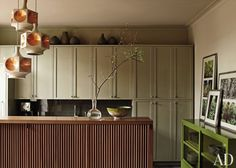 The cabinets are painted in Benjamin Moore's Gettysburg Gray, while Sherwin-Williams's Ethereal Mood coats the walls.