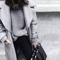 shades of pale grey + black | light grey ribbed top | chunky | knit | oversized sweater | long silver grey thick wool statement coat | oversized, dramatic collar | button up | medium length |  pockets | + black pants | black purse | modern, minimal, chic clean lines | fall/winter fashion | street style inspiration