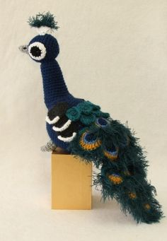 Crochet Toys Design Pattern now available More - Browse all products in the Crochet Patterns category from Suzanne Houghton Illustration. Crochet Birds, Crochet Cross, Cute Crochet, Crochet Animals, Crochet Dolls, Knit Crochet, Peacock Crochet, Amigurumi Patterns, Knitting Patterns