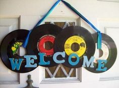 Greeting guests one record at a time.. .  Make a plaque / sign in under 60 minutes by decorating with record. Creation posted by Emily . Difficulty: Simple. Cost: Absolutley free.
