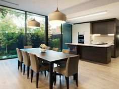 Modern dining room idea with floorboards & floor-to-ceiling windows - Dining Room Photo 1014348