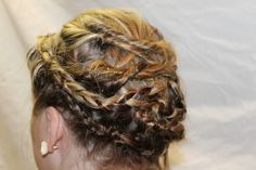 Cute hairstyle that keeps your hair out of your face! Great for work, school, and everyday activities. It can also be dressed up to wear to formal events.