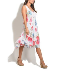 Take a look at this 100% LIN White Floral Kimy Linen Dress today!