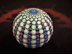 mantala dot painting round stone (a distant planet)