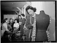 Dressmaking class: Mrs. Ryie Yoshizawa, instructor. Photograph taken at Manzanar by Ansel Adams, 1943