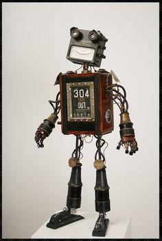 Robot sculptures, designed by Michael Rivamonte. Diy Robot, Robot Art, Robots Robots, Vintage Robots, Retro Robot, Recycled Robot, Recycled Art, Found Object Art, Found Art