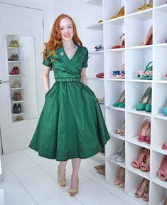 the dress is nice, BUT LOOK AT ALL THOSE SHOES!! Lindybop Vanda emerald green party dress