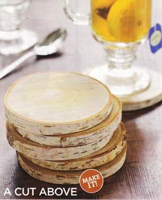 White birch coasters.  I cannot find the magazine article I was reading, but it simply was cutting the slices of birch, sanding them and painting with polyurethane.  They looked just like this!