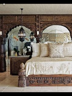 So often heavy traditional furniture would crowd and overpower a room. I've seen architectural pieces used as a headboard before, but never would have concieved of puting a mirror behind them to open up the space. Bohemian Room, Home Bedroom, Traditional Furniture, Indian Bedroom, Bohemian Style Bedroom Design, Family Room Update, Bedroom Decor, Interior Design, Home Decor