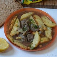 batata koucha algerian is a lamb and chickpea sauce covered with a layer of fried potatoes and oven baked