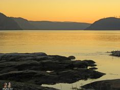 Guide to Tadoussac, Quebec. Tadoussac is our favorite town in the whole province of Quebec. It is situated on the north coast of the St. North Coast, Quebec City, Travel Tips, Mountains, Sunset, Outdoor, Outdoors, Travel Advice, Sunsets