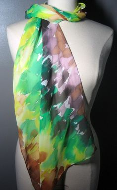 DO NOT BUY unless you are Cher!    Earthy, chocolate browns mix with mint, mustard and apricot accents bringing to mind a beautiful forest dream. The delightful colors of the abstract paint daubs in this scarf reflect the energy of running through the trees - how exhilarating! An elegant and artistic accent to your wardrobe, great for any season. Goes with silver, gold or copper jewelry and so large and versatile to wear and fold so many ways. The silk georgette scarf has a soft, crepe…