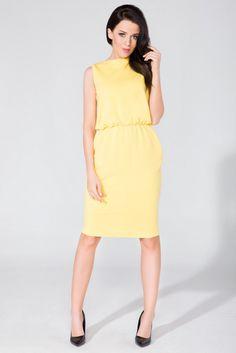 4be1e6aa60 Sukienka Yellow Sukienka z dzianiny o fasonie maskującym niedoskonałości  sylwetki. Na biodrach kieszenie w szwie