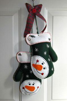 Wool Felt Snowman Mitten Door Hanger In Evergreen by FHGoldDesigns Felt Christmas Decorations, Christmas Ornament Crafts, Christmas Sewing, Felt Ornaments, Christmas Projects, Handmade Christmas, Holiday Crafts, Christmas Crafts, Felt Snowman
