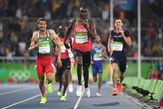 Kenya's David Lekuta Rudisha (C) competes with Algeria's Taoufik Makhloufi (L) to win the Men's 800m Final during the athletics event at the Rio 2016 Olympic Games at the Olympic Stadium in Rio de Janeiro on August 15, 2016.   / AFP / OLIVIER MORIN