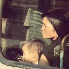 North Korea, woman and child on bus // what a trip!