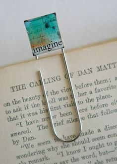 Make a BOOKMARK  to go along with a gift of a book...theme it to match the books such as a cookbook etc. Made from a Scrabble Game Tile, print out a graphic, mod podge and add to a large paperclip...maybe even one of those Jumbo sized ones.