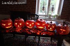 Ms. Ciders has prepared a host of jack-o-lanterns for her Halloween guests.