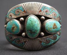 Cuff | Tommy Singer.  1960s - 70s sterling silver with three turquoise stones and chip inlay (Navajo)