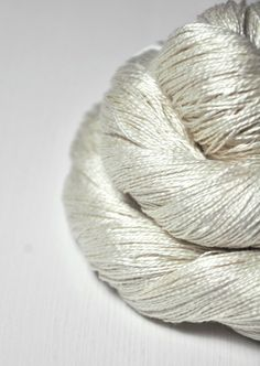 This is undyed silk fine lace - a very pale cream.    ATTENTION: This yarn base comes in 50g skeins!    100% Silk yardage per 100g: 1094 yds. (1000m)