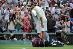 Roger Federer and Fabio Fognini bow to Prince Charles. Wimbledon 2012