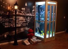 Phone booth aquarium / fish tank with New York City backdrop and props
