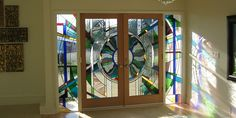 Luxurious interior door with multiple color stain glass panels and stained sidelights   #Door #Stained #Glass