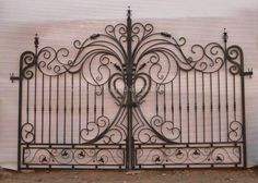 This gate would make a great headboard for a bed.