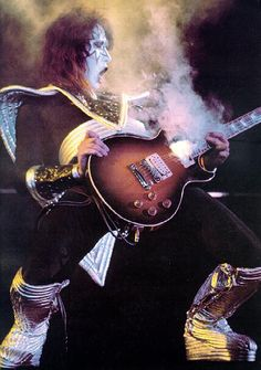 Ace Frehley put a smoke bomb behind the neck pickup of each of his guitars, creating his famous smoking guitar trick.