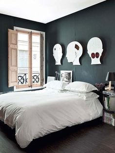 Source: Ideas to Steal  Quirky………love the dark walls. The heads are a little odd but I quite like them. I also like the gun table lamp. It's a Philippe Stark creation for Flos - you can pick it up from Wayfair