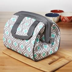 The Charlotte Insulated Lunch Bag is perfect for enjoying lunch at work or school.The Charlotte Bag has a full zip closure and wire frame for easy packing. The