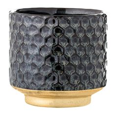 This unique handmade plant pot by Danish brand Bloomingville has a beautiful textured surface and stylish gold base, it's ideal for succulents and small pot plants.Size: Diameter 10 cm x Height 10 cm Material: Stoneware Care: Hand wash