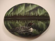 Loon and Northern Lights hand painted on a by wildstonepainter