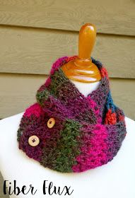 The Autumn Gems Button Scarf is a gorgeous accessory for fall. Crocheted in a simple V stitch, it is easy and quick to work up t...