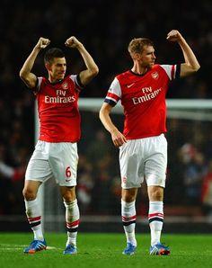 Laurent Koscielny and Per Mertesacker after win against Liverpool