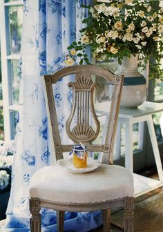 Lovely blue floral curtains and Lyre chair!  (thisivyhouse)