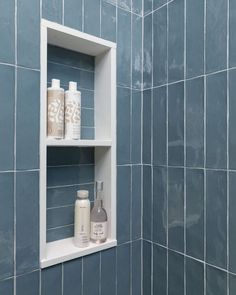 This shampoo niche is tucked behind the corner hidden from view in the bathroom. Trimming it out in solid quartz slab material keeps it easy to maintain and makes for a crisp look. Bathroom Remodel - Carla Aston, Designer | Photographer, Colleen Scott Heated Towel Bar, Penny Tile Floors, Shower Niche, Guest Bathrooms, Bathroom Ideas, Marble Look Tile, Quartz Slab, Kitchen And Bath Design, Blue Tiles