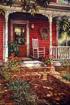 This porch says WELCOME....I love the scroll work on the roof line...RED......!!!!  The rocker and wreath!!!!!