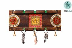 Handcrafted with Dhokra work and bright hues. This Key Ring Holder has Five Key Pegs. Three Bells add to the sheen. An elegant addition to your wall.