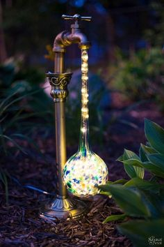 DIY Waterdrop Solar Lights | Easy, budget friendly and one of a kind DIY backyard ornaments and landscape lights | Upcycled candle sticks | Upcycled plant watering globes | Step-by-step tutorial for DIY waterdrop solar lights | DIY whimsical garden lights | Before & After | TheNavagePatch.com #backyardlandscapediyfriends
