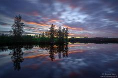 Reflections after sunset on the river Oulujoki, near Oulu in Northern Finland.