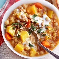 Pumpkin, Chickpea & Red Lentil Stew | This hearty soup boasts a bounty of veggies and seasonings, including pumpkin or squash, fresh ginger, lime juice, cumin and fresh cilantro.
