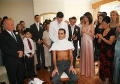 The Koumbaro (best man) shaves the groom (this is known as the last shave).