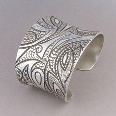 Cuff | Jared Chavez (San Felipe Pueblo). 'Collide'.  Sterling silver